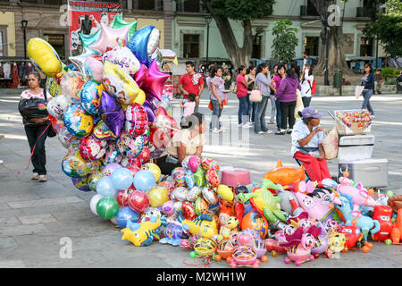 Oaxaca, Mexico - March 7th, 2012: Woman selling bright colorful baloons on a central square in  Oaxaca, Mexico - Stock Photo