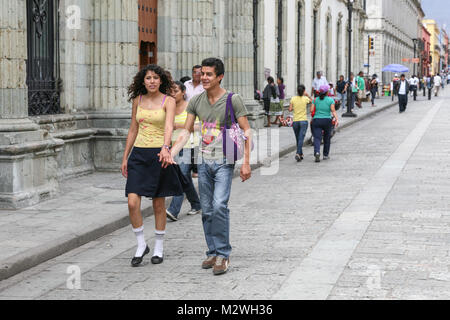 Oaxaca, Mexico - March 7th, 2012: Young couple walking by the central  street in  Oaxaca, Mexico - Stock Photo