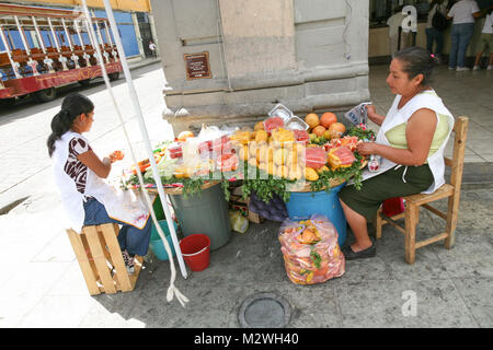 OAXACA, MEXICO - MARCH 7th, 2012: Women selling fresh fruits and juices on a  central  street in  Oaxaca city, Mexico - Stock Photo