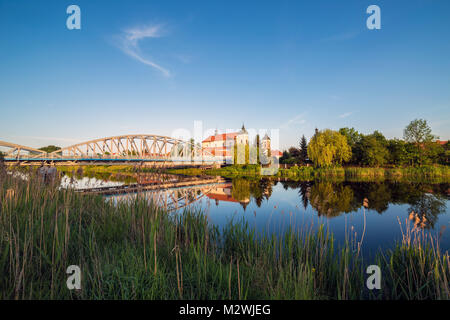 View at bridge over the Narew river and baroque Church of the Holy Trinity in Tykocin town, Podlasie, Poland. - Stock Photo