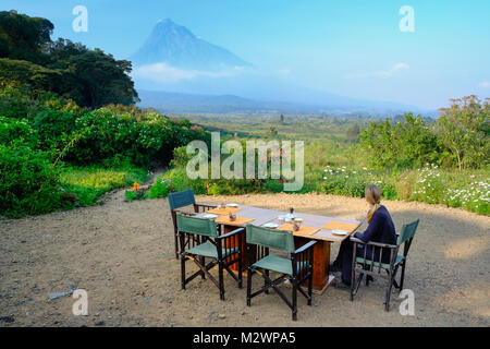 Breakfast at luxury camp overlooking a volcano in the Virunga National Park in the Democratic Republic of Congo, - Stock Photo