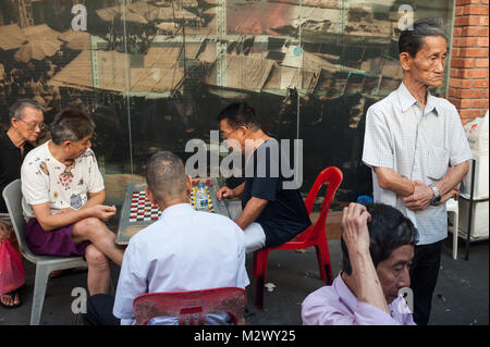 17.12.2017, Singapore, Republic of Singapore, Asia - Elderly men pass the time playing Chinese Chess, also known - Stock Photo