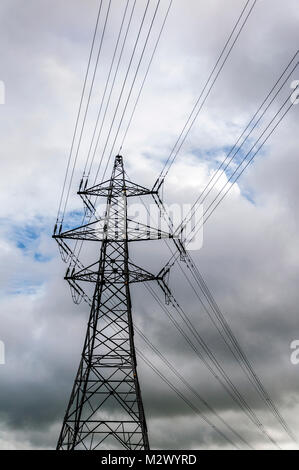 View of electricity pylon with graphic pattern of steel structure in England, UK - Stock Photo
