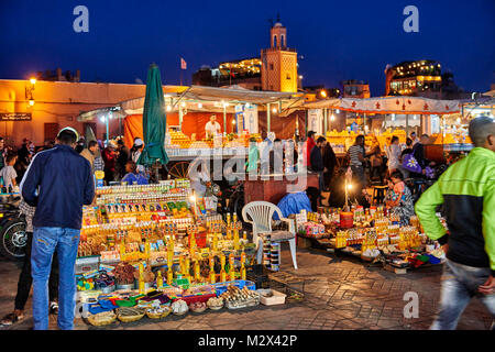 market stall on famous Djemaa el Fna at night, Marrakesh, Morocco, Africa - Stock Photo
