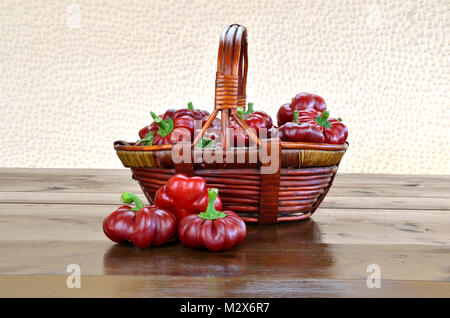 Red Topepo Rosso peppers on a basket - Stock Photo