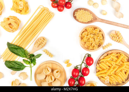 Overhead photo of different types of pasta on white, forming frame - Stock Photo
