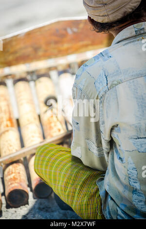 Bali, August 31, 2013: A man plays cymbals on the  beach - Stock Photo
