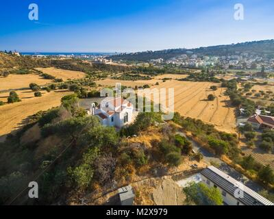 Aerial bird eye view of Saint George chapel (parekklisi Agiou Georgiou) in Germasogia municipality, Limassol, Cyprus - Stock Photo