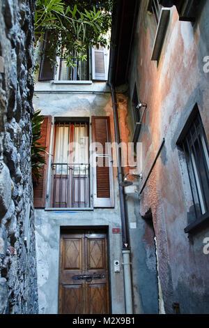 apartment building in a narrow alley of Locarno, Switzerland, Lago Maggiore - Stock Photo