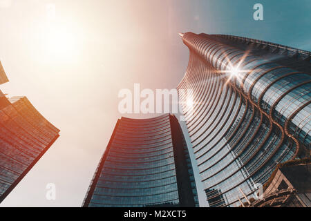 Central tower of the building complex designed by Argentine Architect Cesar Pelli in Piazza Gae Aulenti - Stock Photo