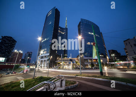 View of modern building at blue hour. The headquarters of business, Italy's largest bank - Stock Photo