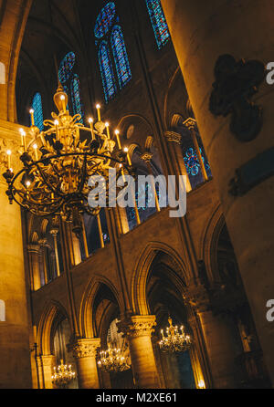 Paris, France - Nov 29, 2013: Interior view of Notre-Dame Cathedral, one of finest examples of French Gothic architecture - Stock Photo