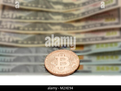 Platinum coin of Bitcoin lies closeup on blurred background - Stock Photo