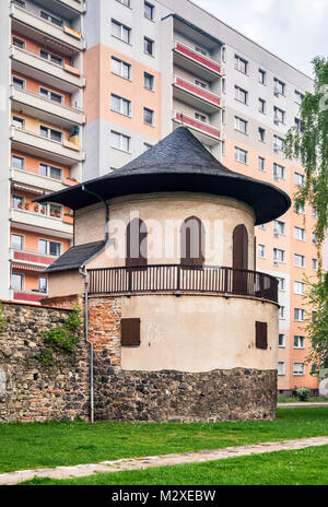 Pulverturm (Powder Tower), defensive wall, high rise apartment building behind, Zwickau, Saxony, Germany - Stock Photo
