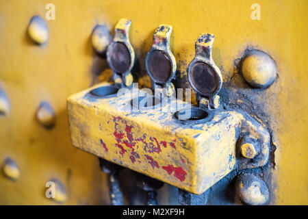 three open latches /   plugs, vintage industrial detail - Stock Photo