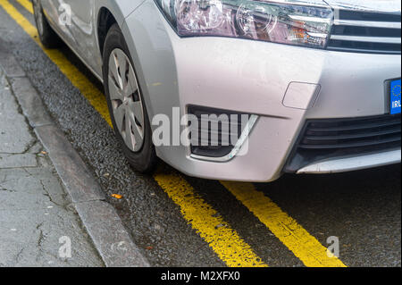 Car parked on double yellow lines/parking violation in Skibbereen, County Cork, Ireland - Stock Photo