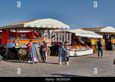 juice stalls on Jemaa el-Fnaa in Marrakesh, Morocco, Africa - Stock Photo