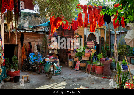 Brightly coloured wool hanging to dry in the dyers souk,  textile souk of Marrakesh, Morocco, Africa - Stock Photo