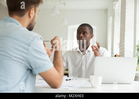 Focused serious african businessman explaining new project to ca - Stock Photo