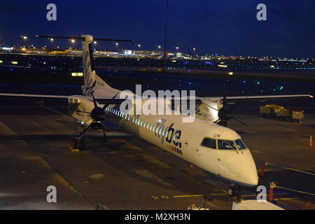 FLYBE BOMBARDIER DASH 8 Q-400 AT SCHIPOL AIRPORT, AMSTERDAM, HOLLAND. - Stock Photo