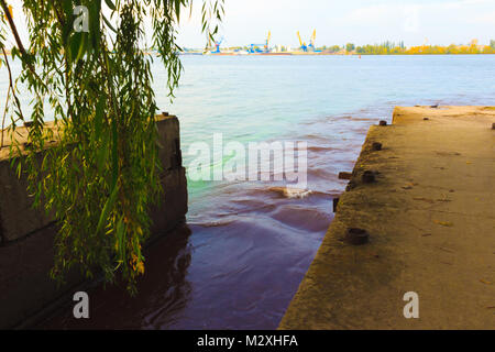 riverscape of large drainage steel pipe background. - Stock Photo
