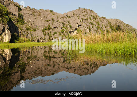 Mountains and reeds in Van Long Nature Reserve, Ninh Binh Province, north Vietnam - Stock Photo