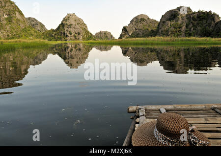 Hat on a boat in the Van Long Nature Reserve, Ninh Binh Province, north Vietnam - Stock Photo