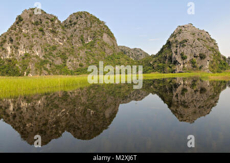 Mountains reflection in Van Long Nature Reserve, Ninh Binh Province, north Vietnam - Stock Photo