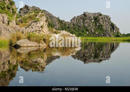 Lake reflection in the Van Long Nature Reserve, Ninh Binh Province, north Vietnam - Stock Photo