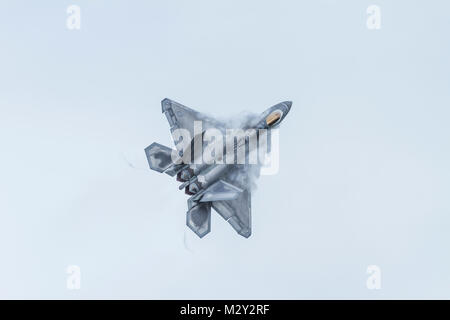 A Lockheed Martin F-22 Raptor from the United States Air Force in a climbing turn with vortices on July 9th 2016 - Stock Photo