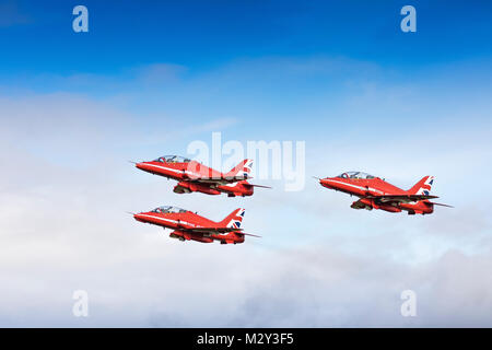 Royal Air Force Red Arrows three ship formation taking off - Stock Photo