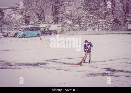 Vintage image car parked in the parking lot covered with white snow after snow falling in winter seasonal. - Stock Photo