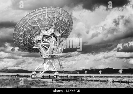 Black & White Photograph of a Very Large Array (VLA) Radio Telescope located at the National Radio Astronomy Observatory - Stock Photo