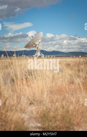 Very Large Array (VLA) Radio Telescopes with nature in the foreground located at the National Radio Astronomy Observatory - Stock Photo