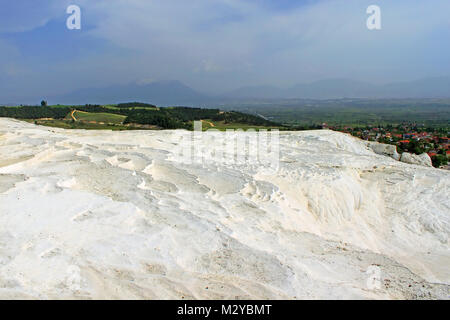 Pamukkale, meaning 'cotton castle' in Turkish, mineral water geyser made terraces for healthy bath - Stock Photo