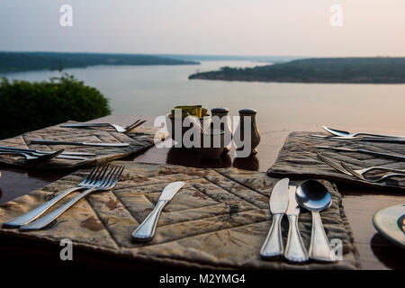Ready set table in a restaurant above the Kazinga channel  linking lake george and lake Edward, Queen Elizabeth National Park, Uganda