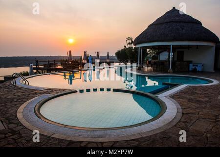 Swimming pool above the Kazinga channel linking lake george and lake Edward at sunset, Queen Elizabeth National Park, Uganda