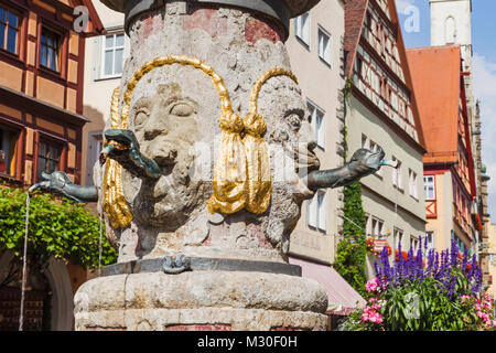 Germany, Bavaria, Romantic Road, Rothenburg ob der Tauber, Street Fountain - Stock Photo