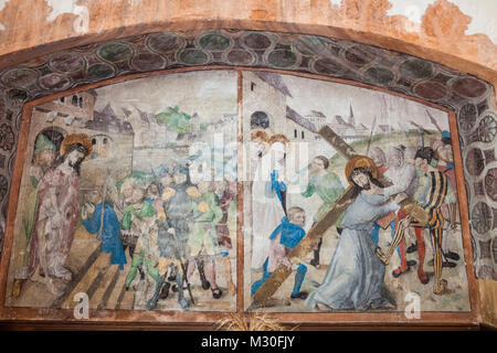 Germany, Rhineland-Palatinate, Oberwesel, St.Martin's Church, 16th century Wall Painting depicting Jesus Carrying - Stock Photo