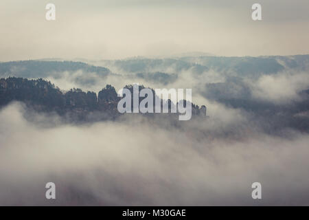 A foggy landscape in saxon switzerland near rathen - Stock Photo