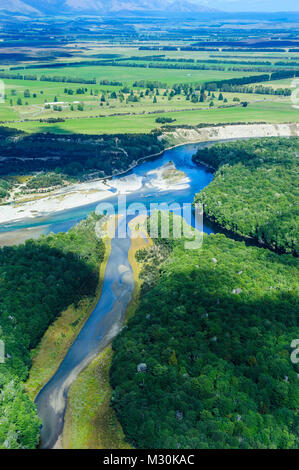 Aerial of a river snaking through Fjordlands, South Island, New Zealand - Stock Photo