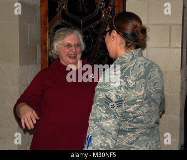 Ms. Gloria Sassman, the deputy human resources officer for the Texas Military Forces, greets a member of the Texas - Stock Photo