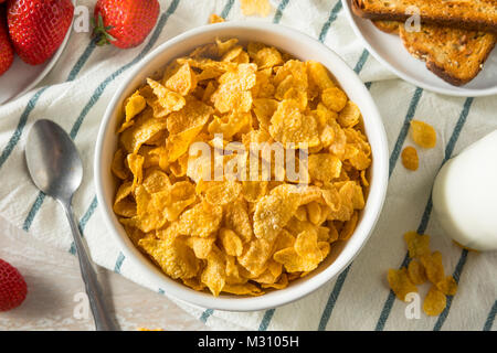 Healthy Corn Flakes with Milk for Breakfast with Fruit - Stock Photo