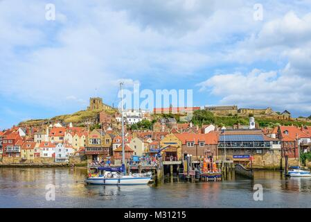 Whitby: Typical harbour view with yacht and lifeboat. - Stock Photo