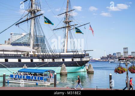 Baltimore Maryland Inner Harbor Patapsco River port waterfront promenade Harborplace attraction water taxi USS Constellation - Stock Photo