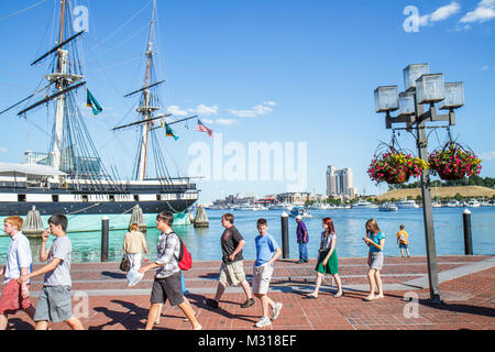 Baltimore Maryland Inner Harbor Patapsco River port waterfront promenade Harborplace attraction water taxi USS Constellation - Stock Photo