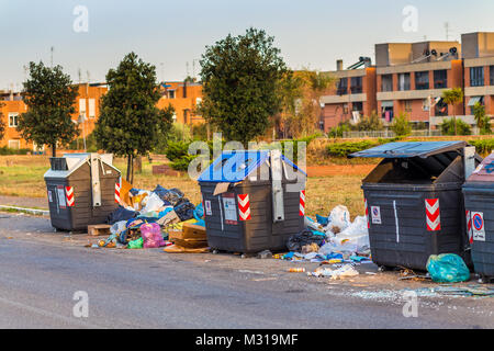 ROME, ITALY - JUNE 23, 2017: Heaps of rubbish left near the garbage cans degrade a residential district - Stock Photo