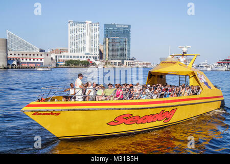 Baltimore Maryland Inner Harbor Harborplace Patapsco River waterfront aquarium skyline Seadog Speedboat Cruises - Stock Photo