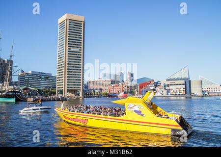 Baltimore Maryland Inner Harbor Harborplace Patapsco River waterfront World Trade Center skyline Seadog Speedboat - Stock Photo