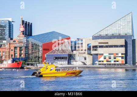 Baltimore Maryland Inner Harbor Harborplace Patapsco River waterfront National Aquarium skyline Seadog Speedboat - Stock Photo
